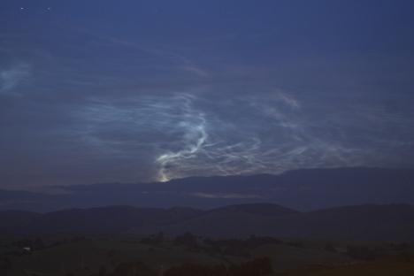bright plume rising above horizon 0030s