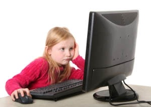 girl looking at computer monitor